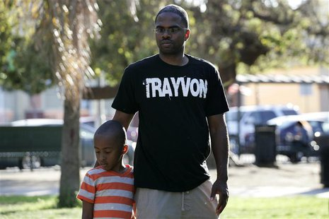 Jovan Blacknell (R) and his son Justice attend a peaceful protest of the acquittal of George Zimmerman for the 2012 shooting death of Trayvo