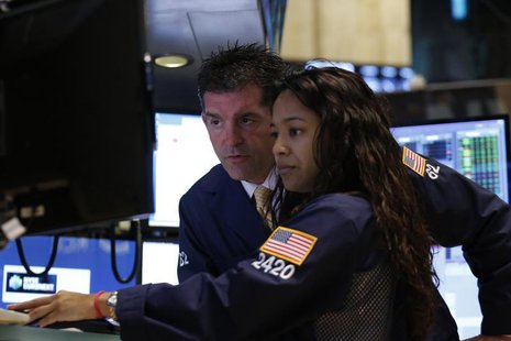 Traders work on the floor at the New York Stock Exchange, July 16, 2013. REUTERS/Brendan McDermid