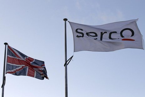 A Serco flag is seen flying alongside a Union flag outside Doncaster Prison in northern England in this December 13, 2011 file photograph. R