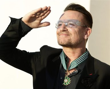 Musician Bono, lead singer of the band U2, reacts after being awarded as Commandeur des Arts et lettres (Commander in the Order of Arts and