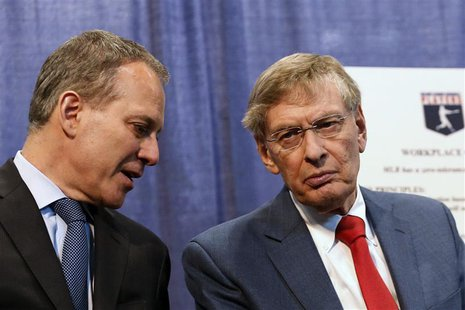 New York Attorney General Eric Schneiderman (L) and Major League Baseball Commissioner Bud Selig attend a news conference about MLB's polici