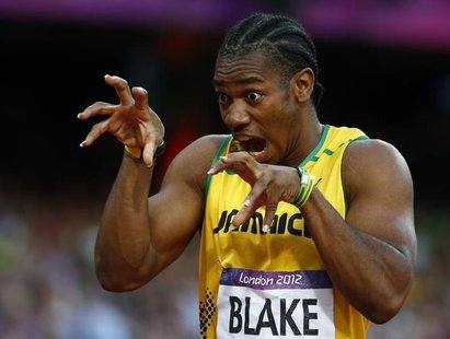 Jamaica's Yohan Blake gestures before the start of his men's 200m semi-final during the London 2012 Olympic Games at the Olympic Stadium Aug