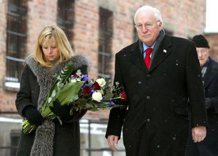 Former U.S. Vice President Dick Cheney (R) and his daughter Liz Cheney Perry walk inside the Auschwitz museum near former death camp Auschwi