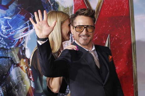 "Cast member Robert Downey Jr. waves next to co-star Gwyneth Paltrow at the premiere of ""Iron Man 3"" at El Capitan theatre in Hollywood, Cali"