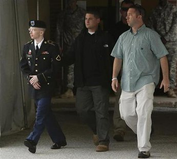 U.S. Army Private First Class Bradley Manning (L) is escorted out after a day of testimony at his court martial trial at Fort Meade, Maryland, July 8, 2013. Credit: Reuters/Jonathan Ernst