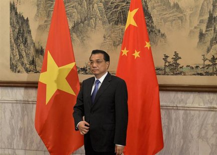 Chinese Premier Li Keqiang prepares to meet the Vietnamese President Truong Tan Sang (not pictured) at the Diaoyutai State Guest House in Be