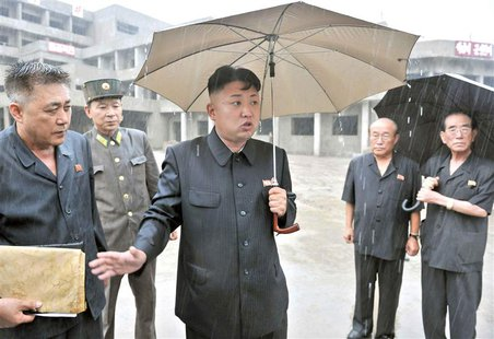 North Korean leader Kim Jong-un gives field guidance to the children's hospital and dental hospital now under construction in this undated p