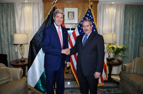 U.S. Secretary of State John Kerry (L) shakes hands with Jordanian Foreign Minister Nasser Judeh during a meeting at a hotel in Amman July 1
