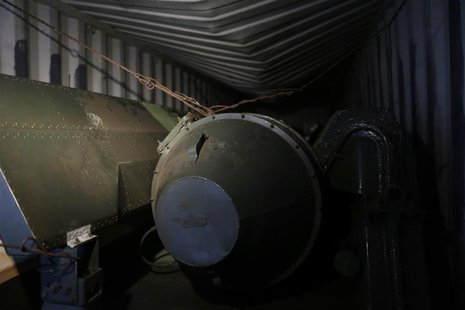 "A long, green missile-shaped object is seen inside the North Korean flagged ship ""Chong Chon Gang"" docked at the Manzanillo Container Termin"