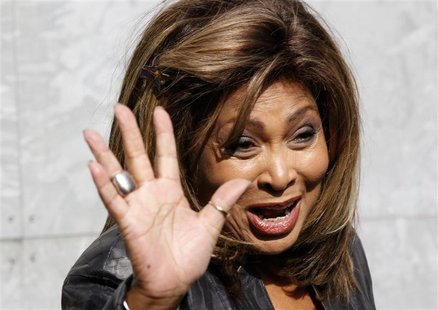U.S. singer Tina Turner waves during a photocall before the Emporio Armani Autumn/Winter 2011 women's collection show at Milan Fashion Week