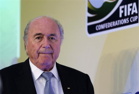 FIFA President Sepp Blatter arrives to a media briefing to discusss the Confederations Cup and the latest preparations for next year's World