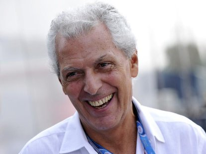 Pirelli president Marco Tronchetti Provera smiles in the paddock after the third practice session of the Italian F1 Grand Prix at the Monza