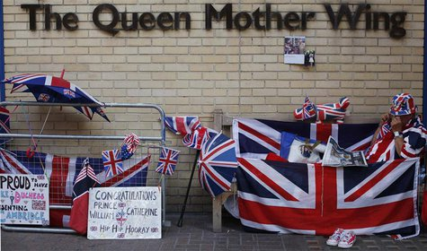 A Royal fan reads the newspaper outside St Mary's Hospital opposite the Lindo Wing, where Britain's Catherine, Duchess of Cambridge is due t