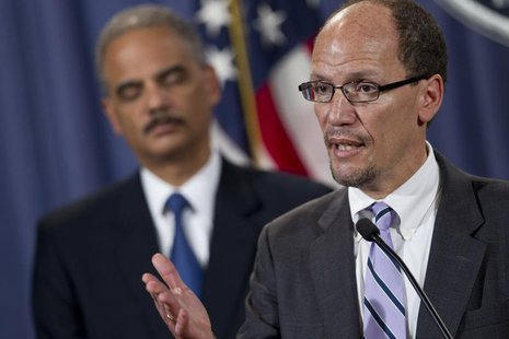 Assistant Attorney General for the Civil Rights Division Thomas E. Perez speaks during a news conference at the Department of Justice in Was