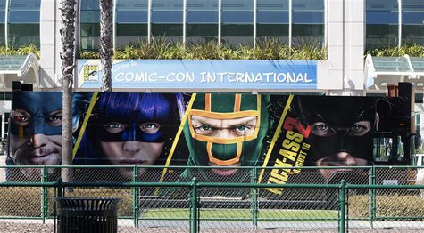 "A bus with an advertisement for the movie ""Kick-Ass 2"" drives past the San Diego Convention Center a day before the start of the 2013 Comic-"
