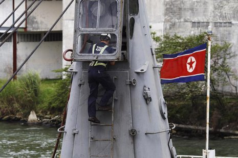 "A worker inspects the North Korean flagged ship ""Chong Chon Gang"" docked at the Manzanillo Container Terminal in Colon City July 16, 2013. R"