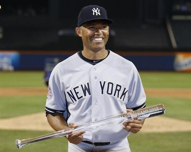 New York Yankees pitcher Mariano Rivera holds a clear bat after being named MVP of the 2013 All-Star Game following Major League Baseball's