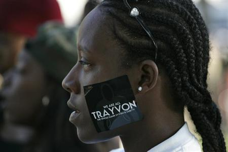 A woman wears a sticker supporting Trayvon Martin during a peaceful protest of the acquittal of George Zimmerman for the 2012 shooting death of Martin, in Los Angeles, California July 15, 2013. Credit: Reuters/Jonathan Alcorn