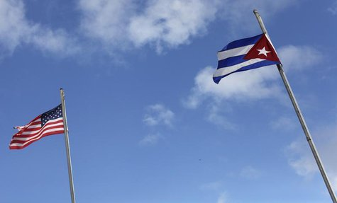 The flags of the United States and Cuba are seen flying in the Little Havana neighborhood of Miami, Florida January 26, 2012. REUTERS/Shanno