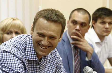 Russian protest leader Alexei Navalny (2nd L) smiles during a court hearing in Kirov, July 18, 2013. REUTERS/Sergei Karpukhin