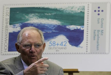 German Finance Minister Wolfgang Schaeuble arrives for a stamp presentation in Berlin July 11, 2013. REUTERS/Tobias Schwarz