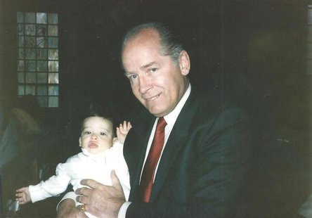"James ""Whitey"" Bulger holds John Martorano's youngest son, John Jr., during his Christening ceremony in this undated handout photo provided"