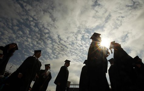 Graduating students arrive for Commencement Exercises at Boston College in Boston, Massachusetts May 20, 2013. REUTERS/Brian Snyder