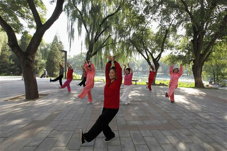 People practise tai chi, a Chinese martial art, during morning exercises at Longtan Park in Beijing September 13, 2010. REUTERS/Grace Liang