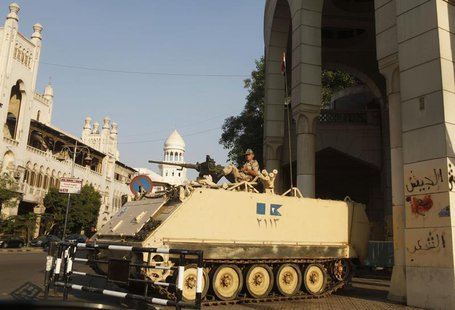 An Egyptian soldier keeps guard from atop a military vehicle in front of the presidential palace in Cairo July 14, 2013. REUTERS/Asmaa Wagui