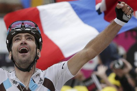 AG2r La Mondiale team rider Christophe Riblon of France celebrates as he wins the 172.5km eighteenth stage of the centenary Tour de France c