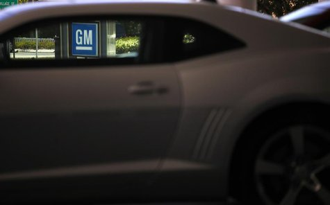 A GM sign is seen at a General Motors dealership in Miami, Florida August 12, 2010. REUTERS/Carlos Barria
