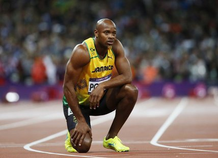Jamaica's Asafa Powell looks at the scoreboard after running in the men's 100m final during the London 2012 Olympic Games at the Olympic Sta