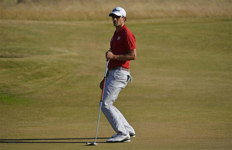 Adam Scott of Australia reacts after making his birdie putt on the 17th green during the first round of the British Open golf Championship a