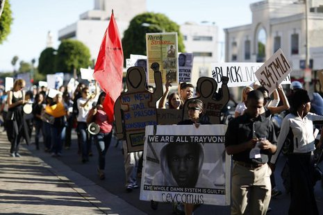 Demonstrators march to protest the acquittal of George Zimmerman in the killing of Florida teen Trayvon Martin in Beverly Hills, California