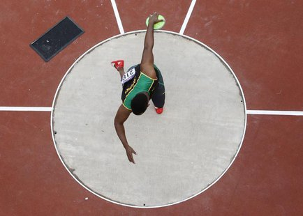 Jamaica's Traves Smikle competes in the men's discus qualification during the London 2012 Olympic Games at the Olympic Stadium August 6, 201