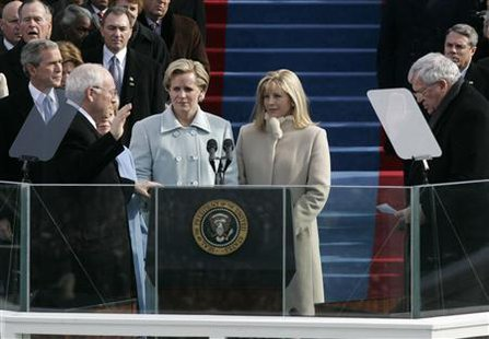 Liz Cheney (2nd R) with her sister Mary (2nd L) watches her father U.S. Vice president Dick Cheney (L) taking the oath for his second term in office from House Speaker Dennis Hastert (R) at inaugural ceremonies in Washington in this January 20, 2005 file photo.  REUTERS/Jason Reed/Files