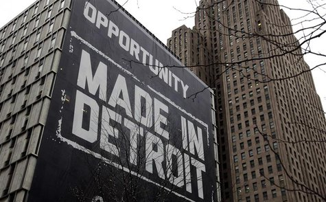 "A large ""Opportunity Made In Detroit"" banner is seen on the side of a building in downtown Detroit, Michigan in this January 30, 2013 file p"