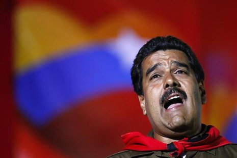 Venezuela's acting President and presidential candidate Nicolas Maduro sings during a campaign rally in Caracas April 5, 2013. REUTERS/Carlo