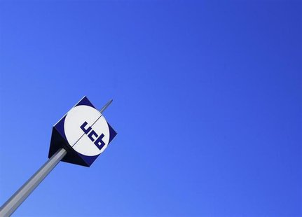 The logo of Belgian drug, chemical, and plastics group UCB is seen at the entrance of the company's headquarters in Brussels March 2, 2010.