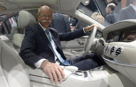 Dieter Zetsche, CEO of German carmaker Daimler, poses in a new Mercedes-Benz S-class car during a presentation in Hamburg, May 15, 2013. REU