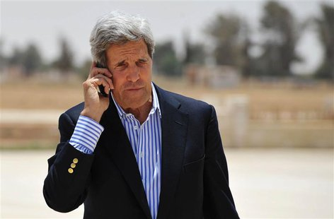 U.S. Secretary of State John Kerry speaks on the phone at Mafraq Air Base before boarding a helicopter to Amman, after visiting Zaatari refu