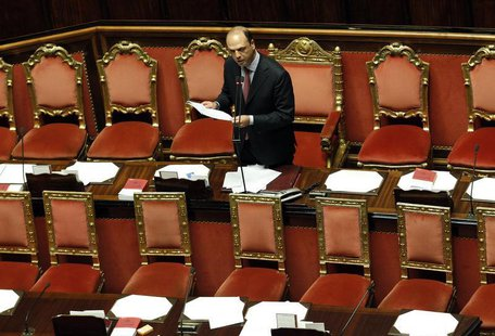 Deputy Prime Minister and Interior Minister Angelino Alfano reads a document at the Upper house of the parliament in Rome, April 30, 2013. R