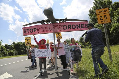 Protesters against drone strikes walk along the highway with a model of a drone in an attempt to deliver a letter to U.S. Central Intelligen