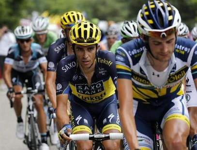 Team Saxo-Tinkoff rider Alberto Contador (C) of Spain climbs the Alpe d'Huez mountain during the 172.5km eighteenth stage of the centenary T