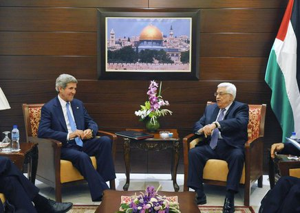 U.S. Secretary of State John Kerry (L) meets with Palestinian President Mahmoud Abbas at the Mukataa compound, in the West Bank city of Rama