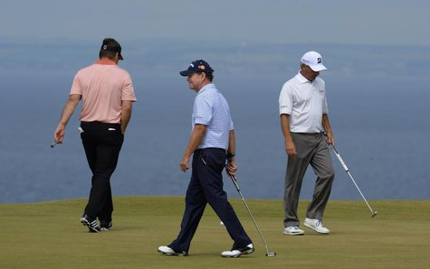 Nick Faldo of England, Tom Watson of the U.S, and Fred Couples of the U.S (L-R) walk across the 11th green during the first round of the Bri