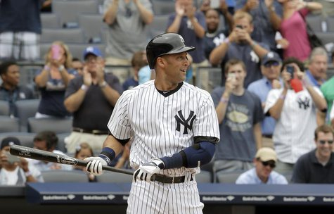 New York Yankees batter Derek Jeter stands at the plate for his first at-bat against the Kansas City Royals in the first inning of their MLB