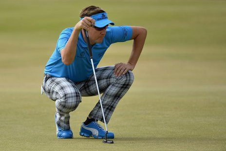 Ian Poulter of England lines up his putt on the second green during the first round of the British Open golf Championship at Muirfield in Sc