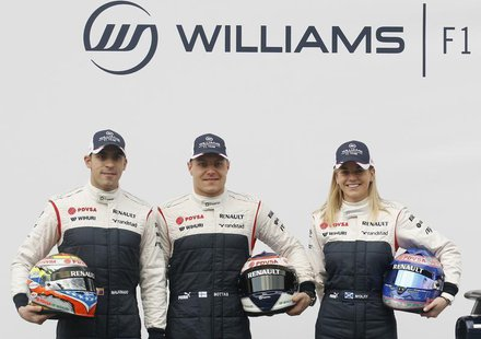 (L-R) Williams Formula One drivers Pastor Maldonado and Valtteri Bottas and test-driver Susie Wolff pose with the new FW35 racing car during