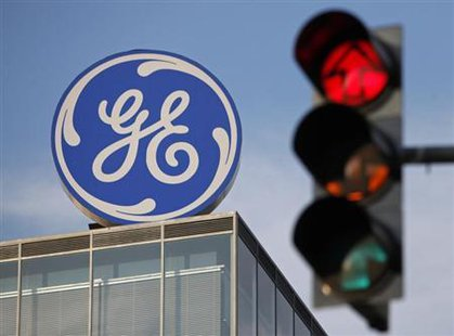 The logo of the GE Money Bank is seen behind a traffic light in Prague May 29, 2012. Credit: Reuters/David W Cerny